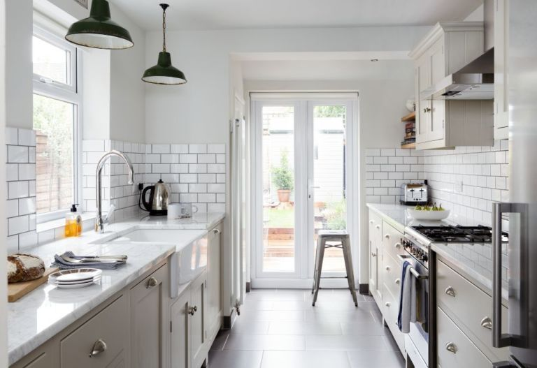 Grey Grouting Was Used With Metro Wall Tiles For A Contemporary Edge. The  Units Are From Devol Kitchens.