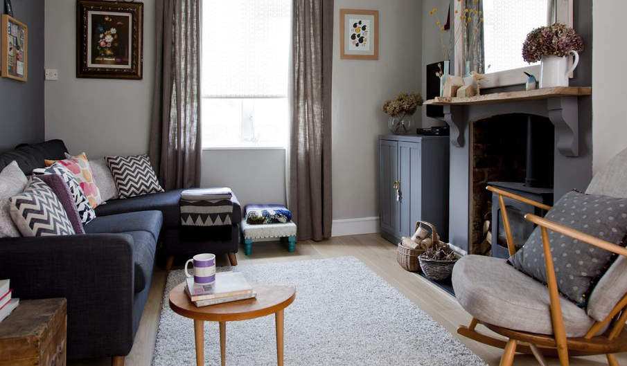 cosy dark grey living room furnished with upcycled and vintage