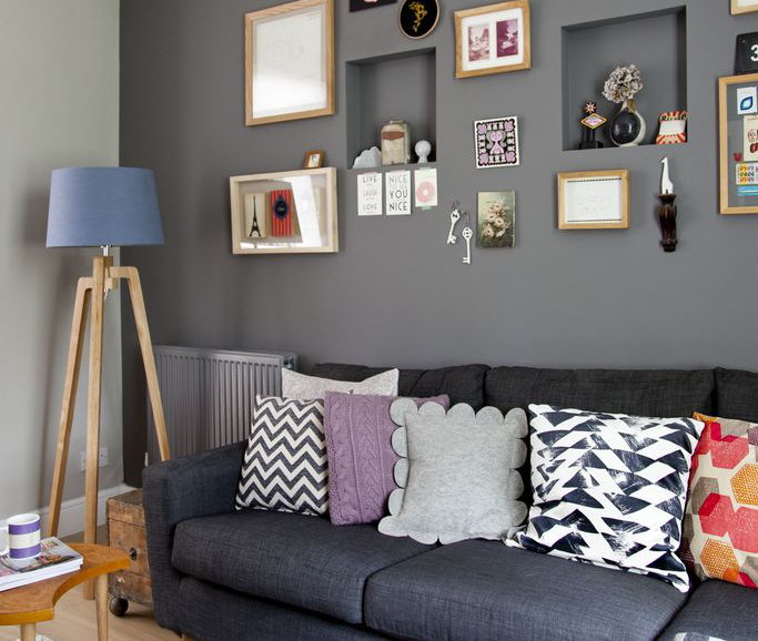 A Cosy Dark Grey Living Room Furnished With Upcycled And Vintage