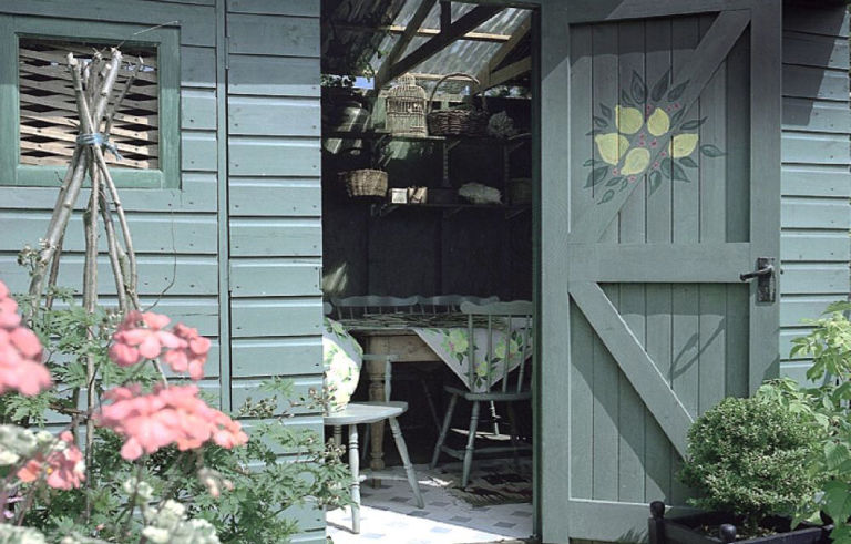 pastel green exterior house colour confident outdoor space and gardens