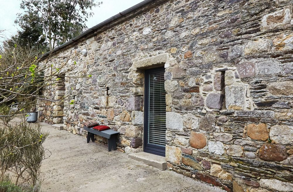 Granite Stone Foundation : Modern home with stone walls used to be two tumbledown
