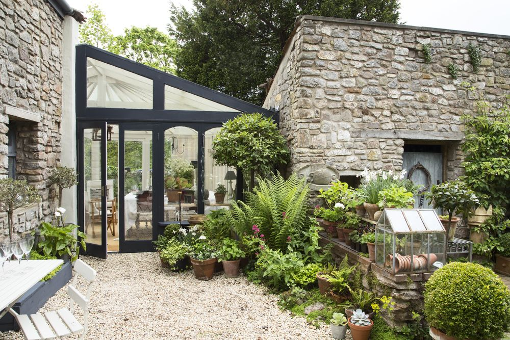 Courtyard garden boasts stone walls scented plants and for Courtyard stone landscape