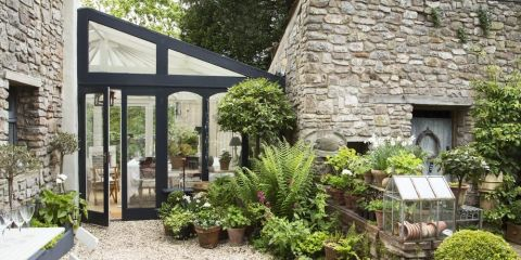 Courtyard Garden Boasts Stone Walls Scented Plants And Potted Evergreens