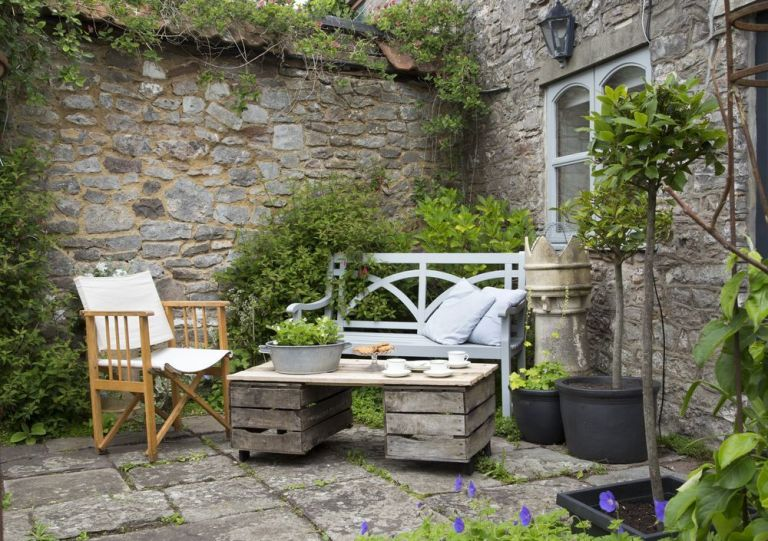 Courtyard Garden Boasts Stone Walls Scented Plants And Potted