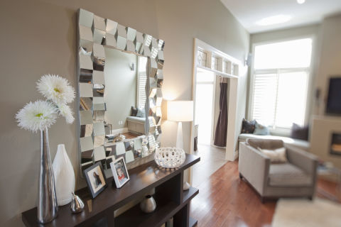 10 fabulous statement wall mirrors for Mirror placement in living room