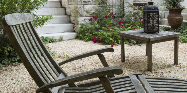 table and chair in backyard of courtyard garden - Garden Design Long Narrow Plot