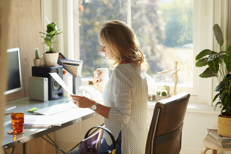 picture of home office. brilliant home woman drinking coffee and reading paperwork at desk in sunny home office intended picture of home office d