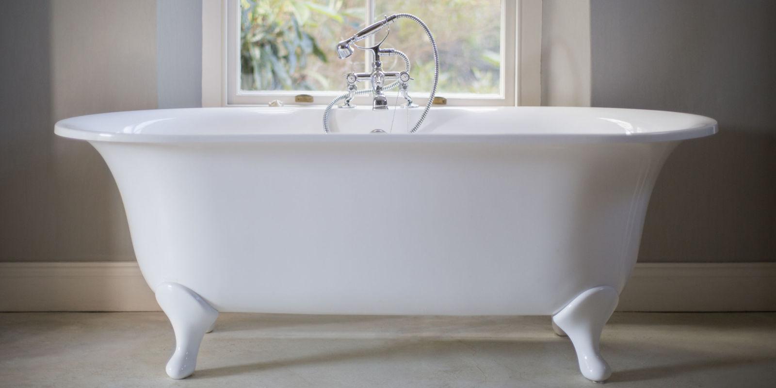 Replacing a retro coloured bathroom suite - Freestanding White Bath In Bare Bathroom