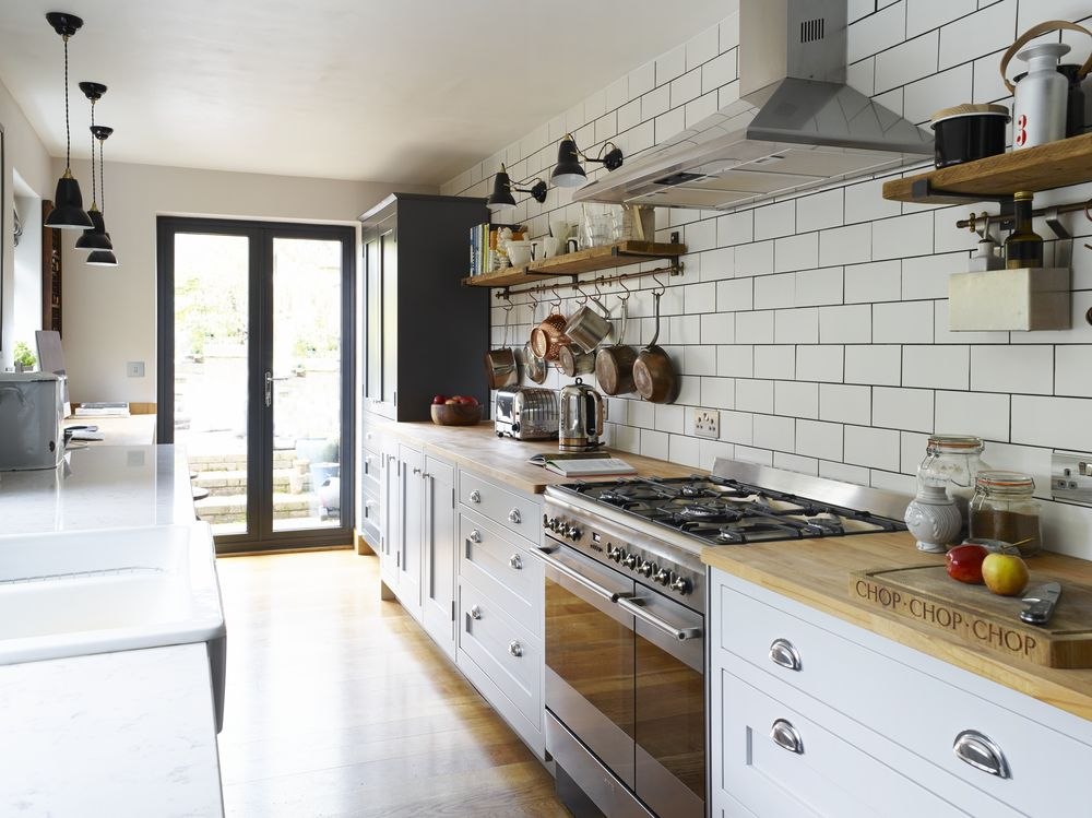 This shaker style galley kitchen merges vintage with for Shaker style house