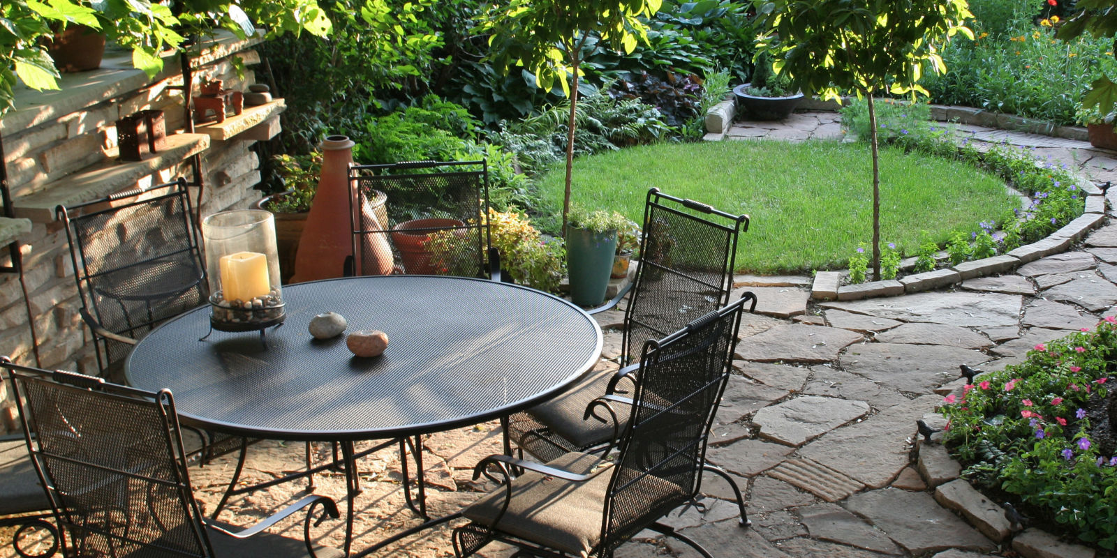10 top tips to get your patio garden ready for summer for Landscaped back gardens