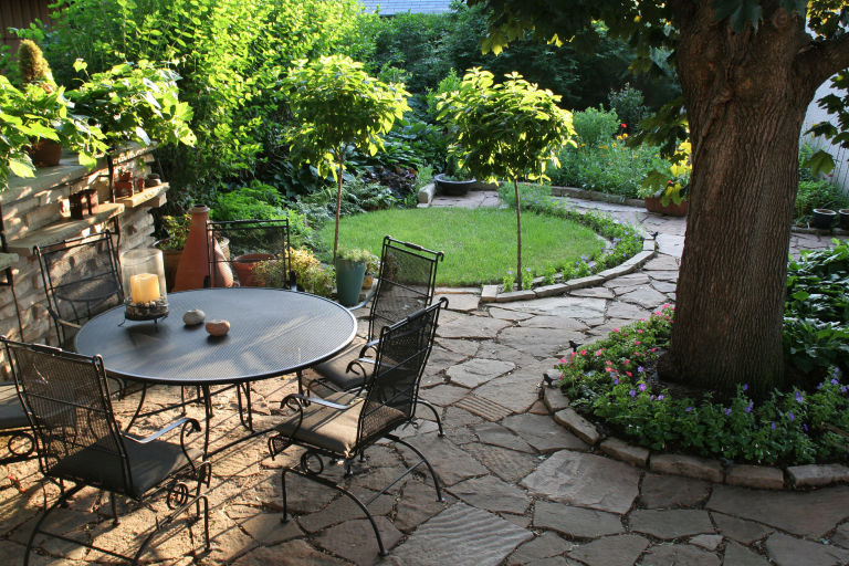 Landscaped Back Yard Patio, Flower Garden With Natural Paving Stones