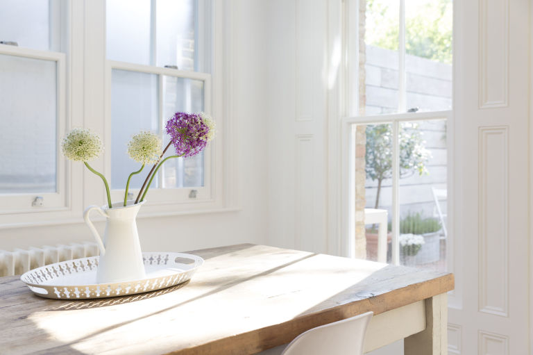natural lighting in homes. flowers in vase on wooden table with natural light lighting homes