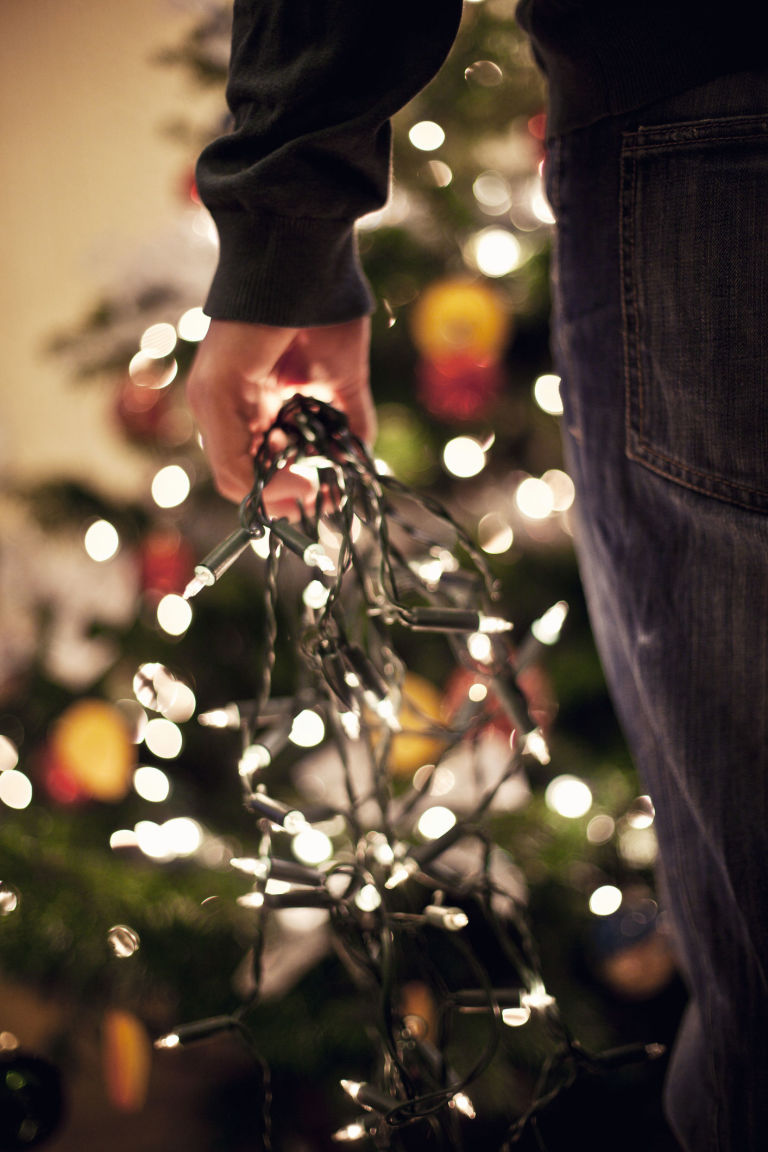 Christmas Decorations Up Part - 34: Man Putting Up Christmas Decorations, Holding Fairy Lights
