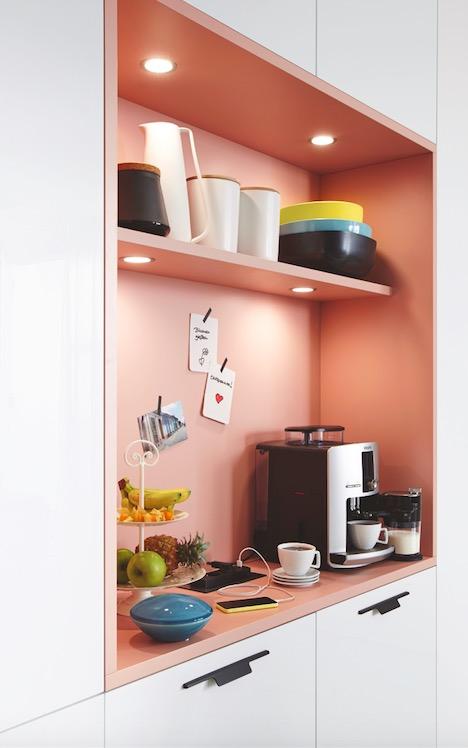 Pink kitchen cabinet shelf. '