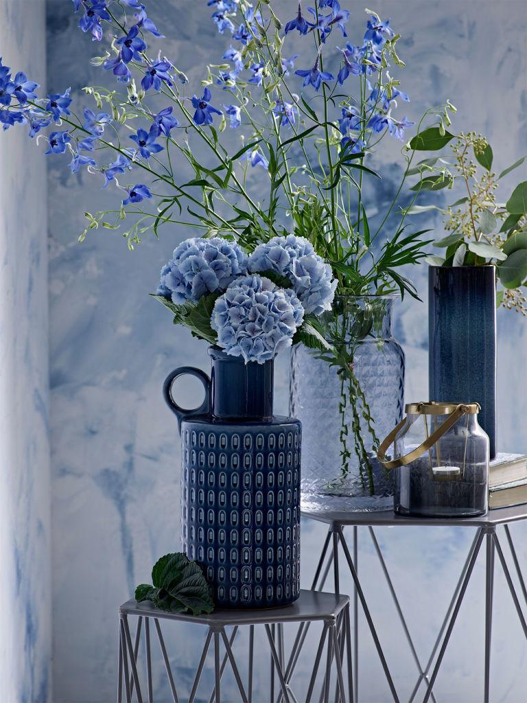 Indigo blue flowers, vase and backdrop