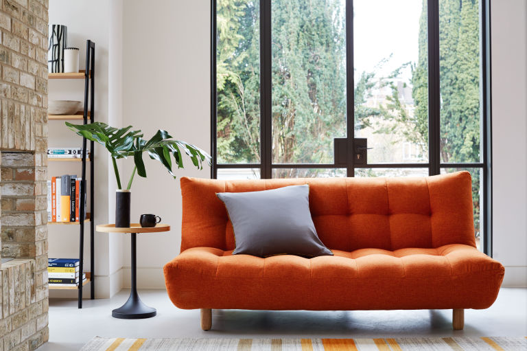 Orange sofa living room design - Habitat and Topology Interiors - small space living
